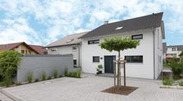 Außenansicht Doppelhaushälfte U089 mit Satteldach von TALBAU-Haus