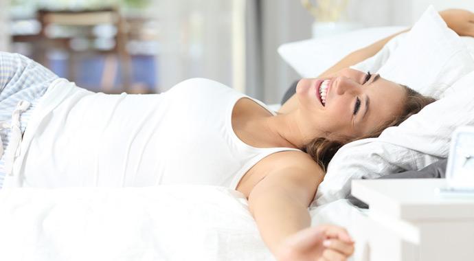 Symbolbild Frau im Bett